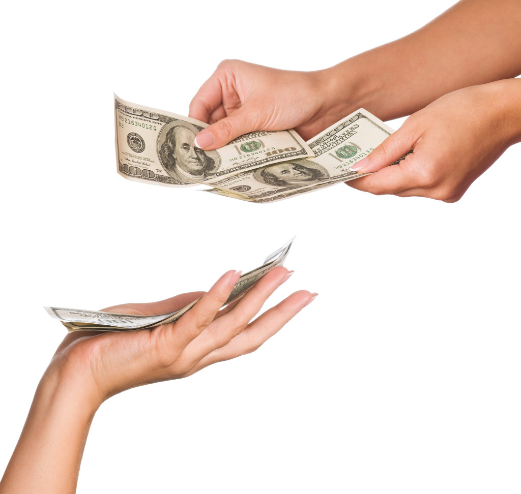 bigstock-Hands-holding-money-dollars-is-26575568
